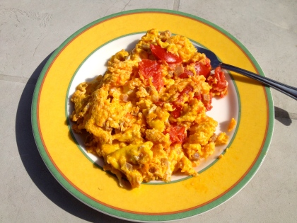 Homegrown eggs and tomato scramble.